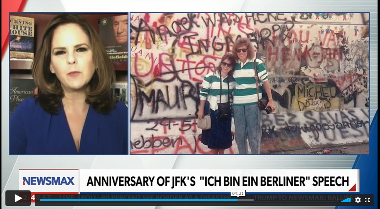 Jane, left, visited the Berlin Wall in 1989 a few months before it fell.